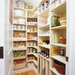Walk In Industrial Shelves In White Which Consist Of Wine Racks Trays And Rattan Baskets