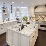 White And Black Island Countertop Chandelier Built In White Cabinet Tiled Hood Accent Backsplash Recessed Lights