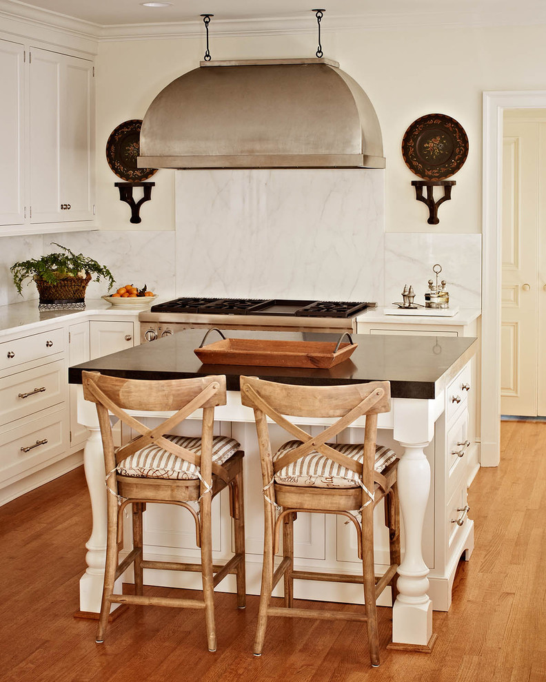 white classy wooden island with black marble top, brown wooden stools with back and brown white striped cushion