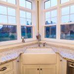 White Corner Cabinet Under White Sink And White Granite Countertop