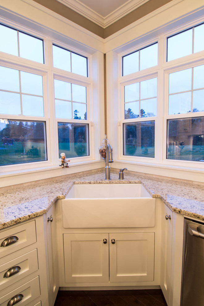 white corner cabinet under white sink and white granite countertop