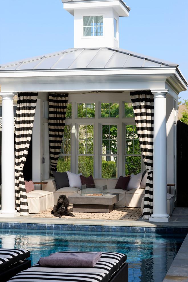 white gazebo with aluminium roof, striped curtains, glass windows on the back, off white sofa set, tiles floor