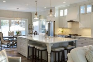 white large kitchen island with storage for wooden stools with white leather seating