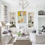 White Living Room Furniture Set Artistic Woman Painting With Playful Colors Recessed Rack With Under Cabinets White Area Rug White Pendant Lamp