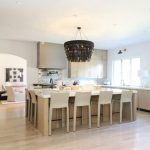 White Square Kitchen Island With Two Sides For Seating Area With White Stools With Back And Beautiful Chandelier On Top