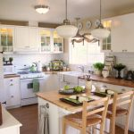 White Wooden Kitchen Island With Towel Rack On The Side, Brown Wooden Top, Brown Wooden Stools With Backs And Rattan Seating