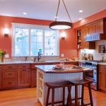 Wooden Kitchen Cabinet With White Kitchen Island With Brown Wooden Countertop And Two Wooden Stools
