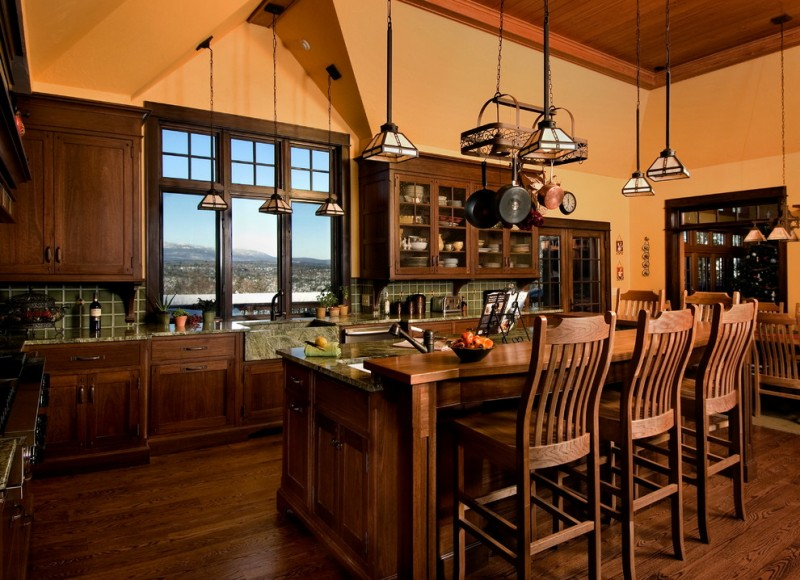 wooden kitchen island with added higher wood for bar seating with wooden stool with backs
