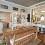 Wooden Kitchen Table And Benches Candle Holders Medium Toned Wooden Floor Accent Chairs Wall Art Works Kitchen Island Steel Appliances