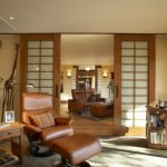 Asian Living Room With Beige Walls Frosted Glass Sliding Doors With Wooden Trims Leather Brown Sofa Cream Rug Light Toned Wooden Floors Brass Standing Lamp