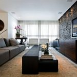 Contemporary Open Concept Family Room Idea With A Wall Mounted TV Black Painted Wall Gray Sofa Black Table White Curtains Cream Rug
