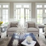 Expansive Elegant Formal Open Concept Living Room With Gray Walls White Doors And Window Trim White Rug And Tables White Table Lamp