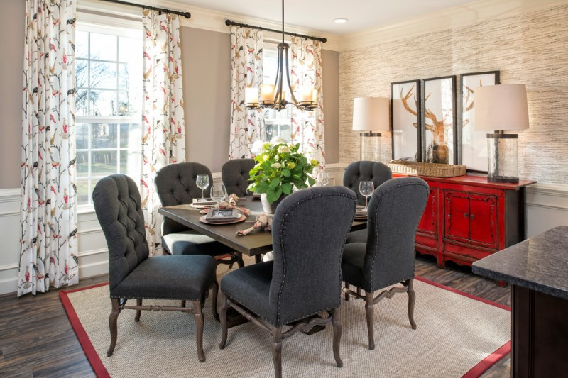 French style dining set red hall console three mirrors with black frames multicolored draperies dark hardwood floors traditional pendant lamp