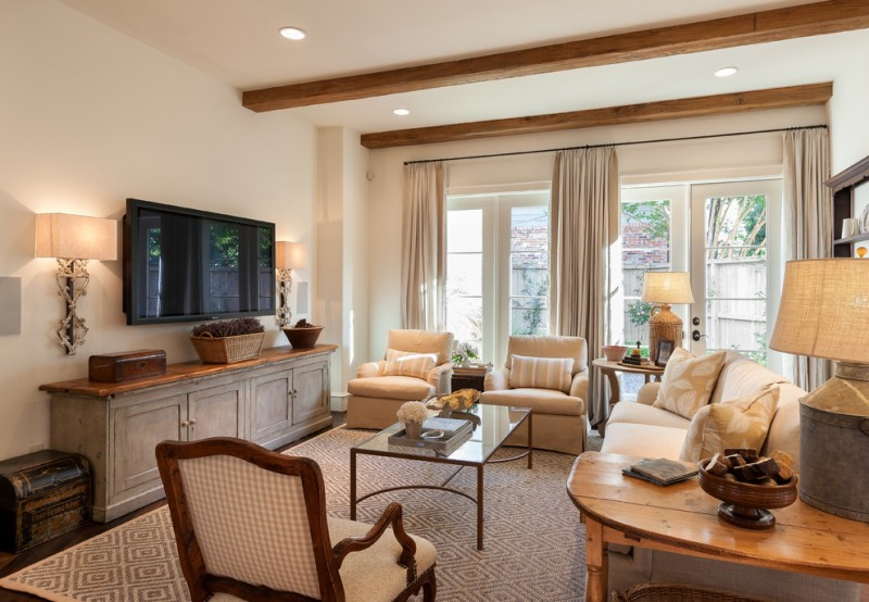 Mid Sized Traditional Family Room With Beige Walls A Wall Mounted Tv And Dark Hardwood