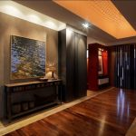 Rustic Entry Hall With A Double Front Door Wooden Table Medium Toned Wooden Floors Ceramic Tiles Floors Window Shade Fixed Lamp