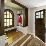 Small Craftsman Front Door With Gray Walls, Medium Tone Hardwood Floors, A Single Front Door And A Medium Wood Front Door