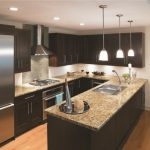 Traditional Kitchen With Dark Cabinets Light Toned Wooden Floors Black Painted Kitchen Island Silver Appliances Pendant Lamps Ceramic Backsplash Wooden Floating Cabinets