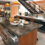 Trendy Kitchen With Stainless Steel Appliances, A Drop In Sink, Flat Panel Cabinets, Granite Ceramics Tiles And Laminate Countertops Wooden Stairs