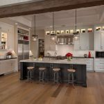 White Laminate Kitchen Island Black Painted Doors White Painted Kitchen Cabinets Floating Cabinets Light Toned Wooden Floors Glass Doors Divider Silver Appliances
