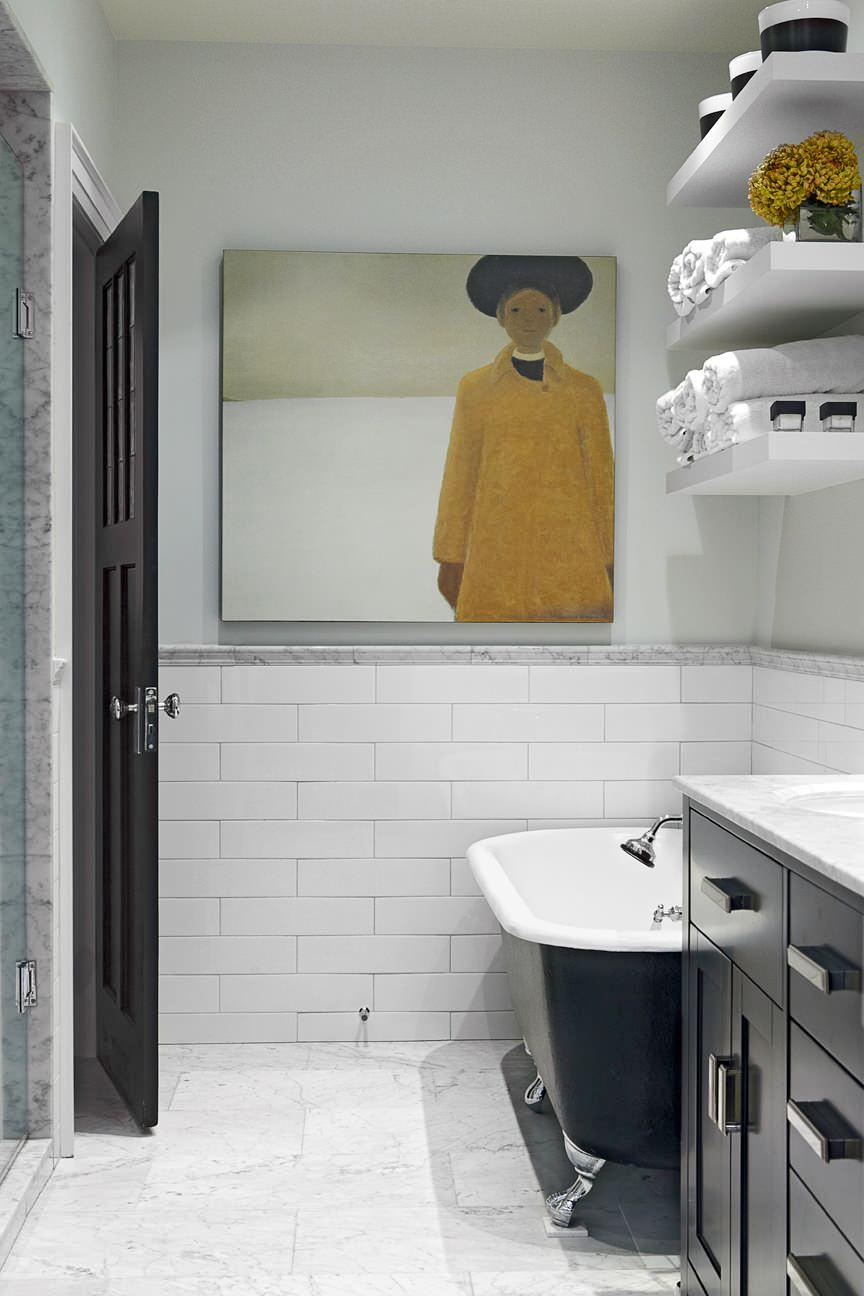 artwork tiled wall marble floor black free standing tub open floating shelves black vanity