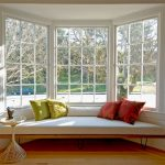Bay Window White Trim White Trellis Window Seat Colored Throw Pillows Cushions Accent Table