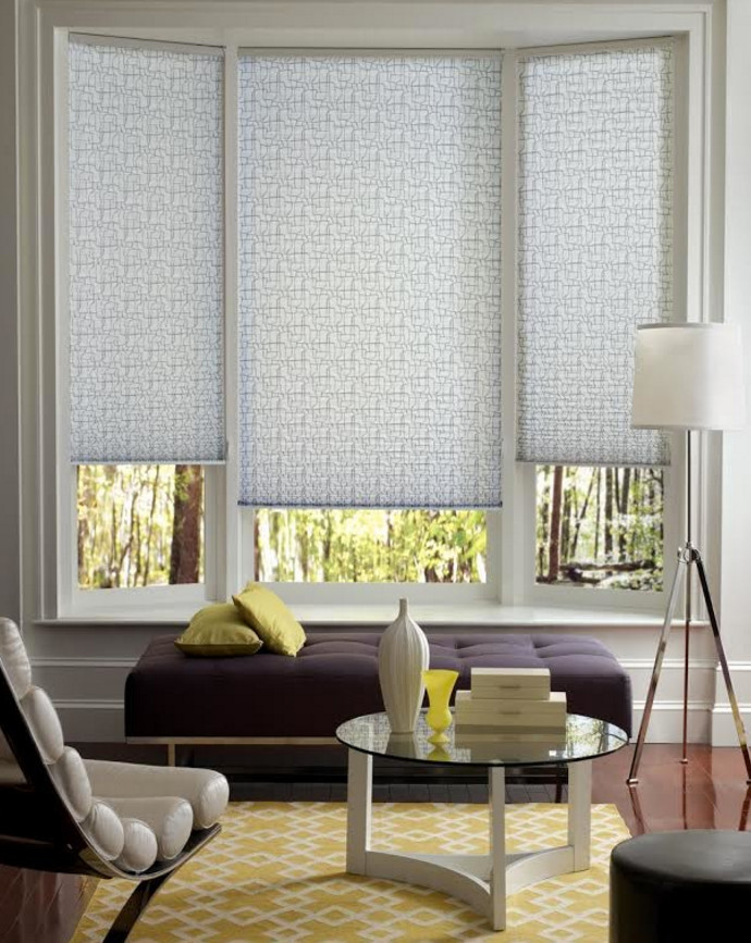 bay window white trim window covering purple ottoman buil in window bench lounge round glass table floor lamp area rug