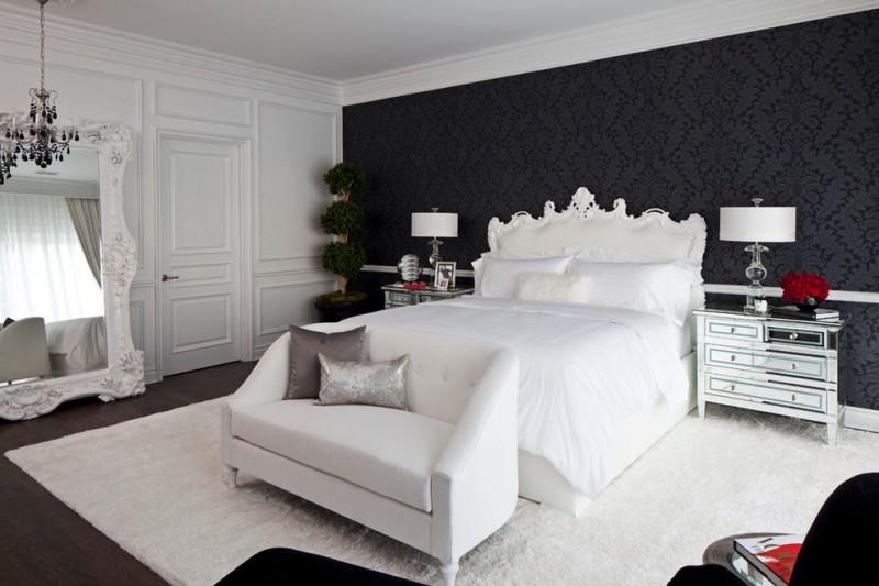 black and white bedroom black patterned wallpaper white bed white side small sofa soft large white rug white framed floor mirror black chandelier