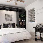 Black And White Bedroom White Bedding Black Pillow And Shelves Rug Ceiling Lamp And Fan Black Table Window Shade