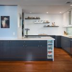 Blue Wall Blue Tiled Backsplash Flat Panel Cabinet Bookd Shelves Floating Shelves Undermount Sink Recessed Lights