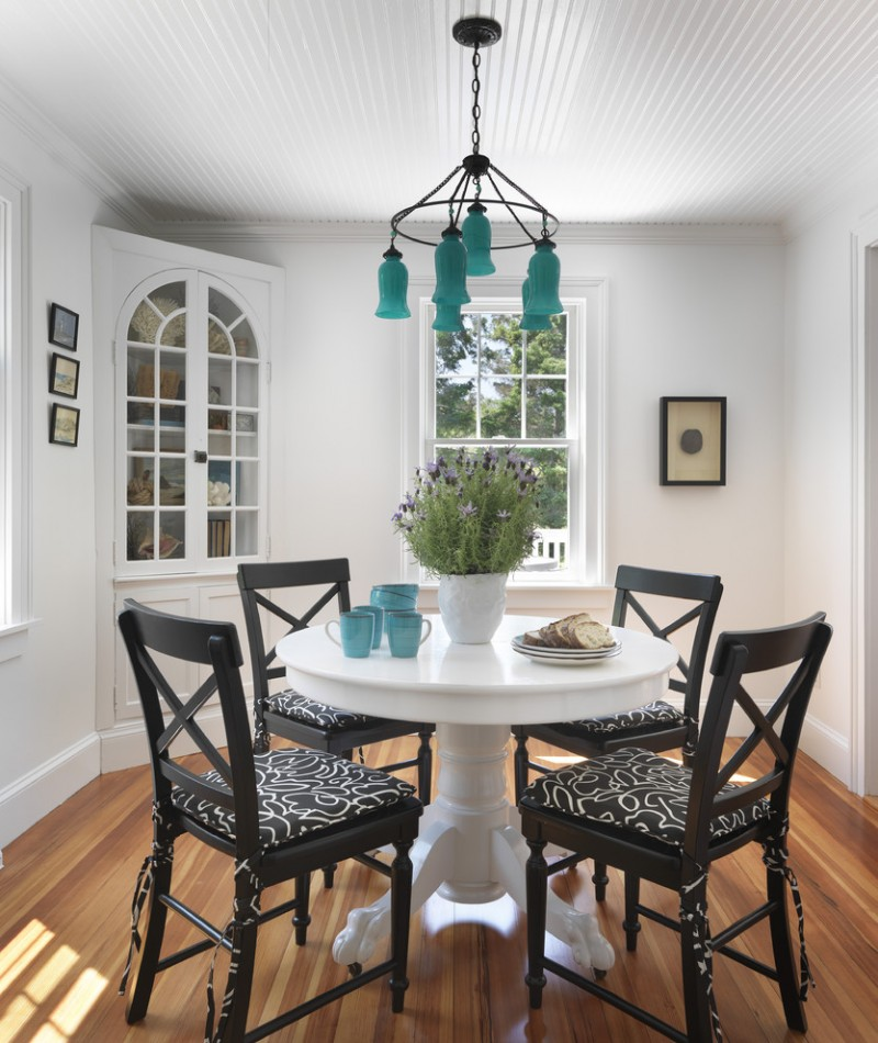built in corner cabinet in white black painted dining chairs with black white textile round shaped dining table in white medium toned wood floors