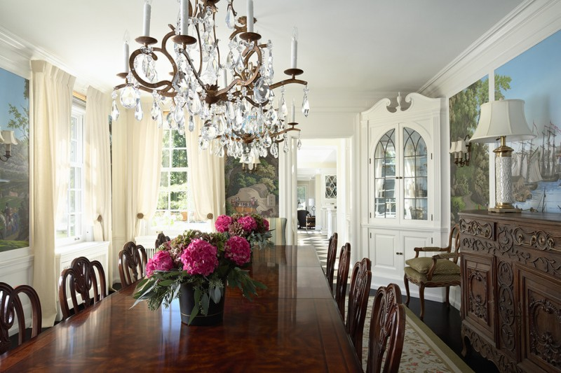built in corner cabinets with decorative glass door handcrafted hall table luxurious hardwood dining table in dark finishing handcrafted wood dining chairs luxurious crystal chandelier