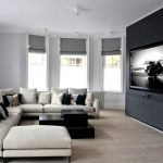 Contemporary Living Room L Shaped Sectional In White With Additional Chaise Black And White Throw Pillows Layered And Asymmetrical Table In Black Recessed TV Set