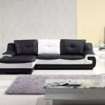 Contemporary Living Room Black And White Leather Sofa Grey Area Rug White Floors Modern Grey Coffee Table Grey And Cream Walls Black Floor Lamp