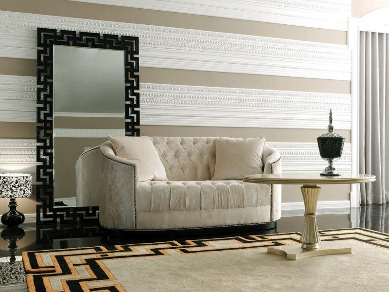 cozy white sofa with white throw pillows round top table with black table lamp standing mirror with black frame area rug with black yellow accent colors