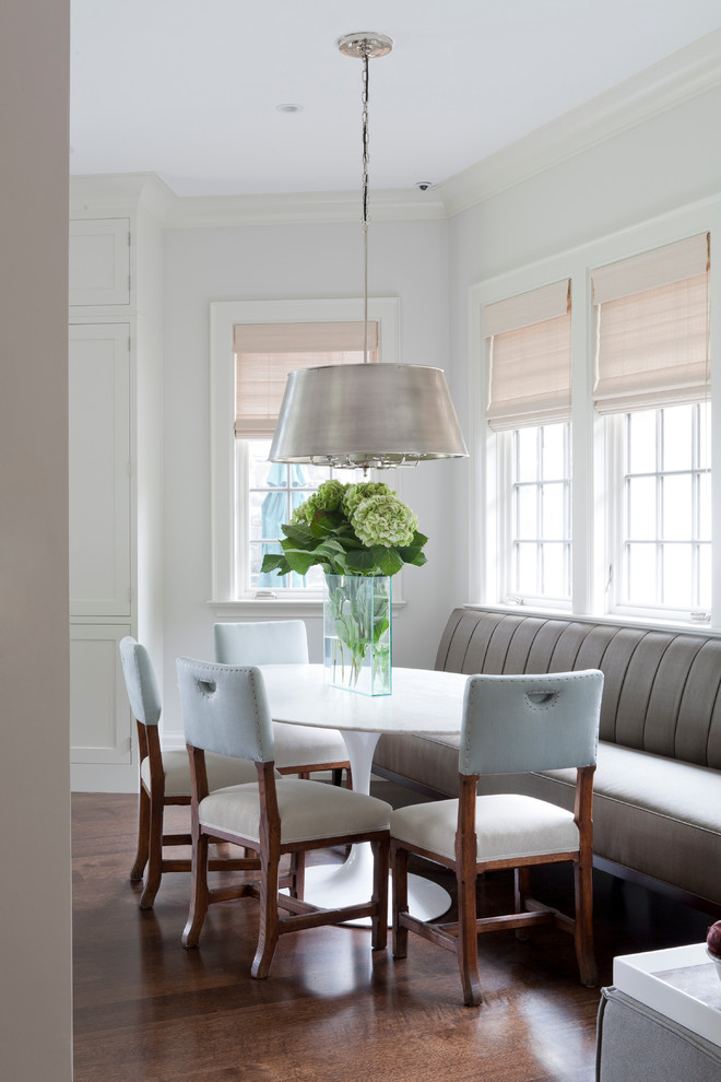 dining room decorating ideas saarinen oval dining table flowers arrangement with unique glass vase chairs hardwood flooring industrial chandelier