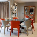 Dining Set With Glass Table, White And Orange Sleek Chairs