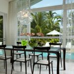 Dining Set With Glass Top Table With Black Chairs With White Seating
