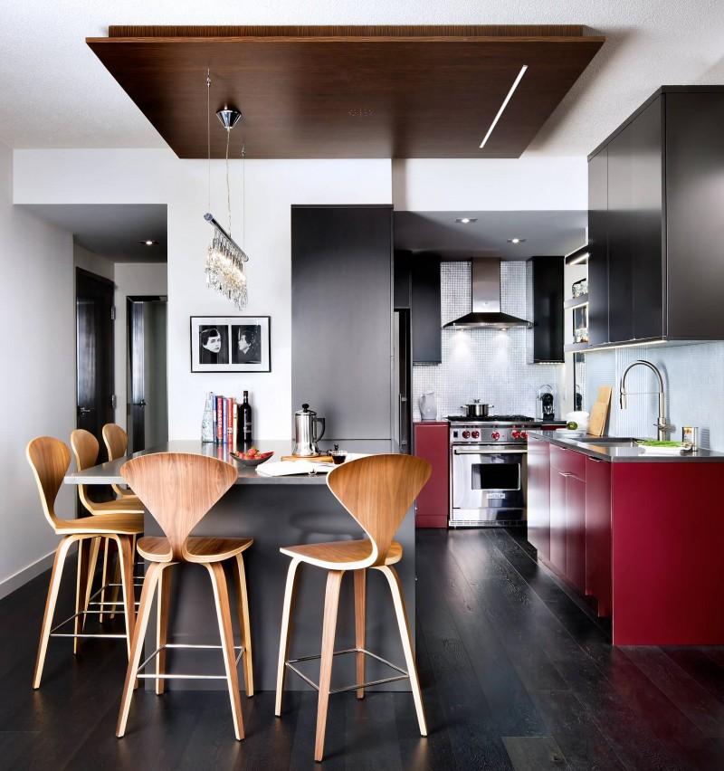 dropped wooden ceiling flat panel cabinet purple cabinet dark cabinet bar stools peninsula ceiling lights dark wooden floor