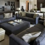 Expansive Classic Open Concept Living Room With White Walls, A Home Bar, Carpet And A Built In Media Wall Table Lamp Wooden Cabinets