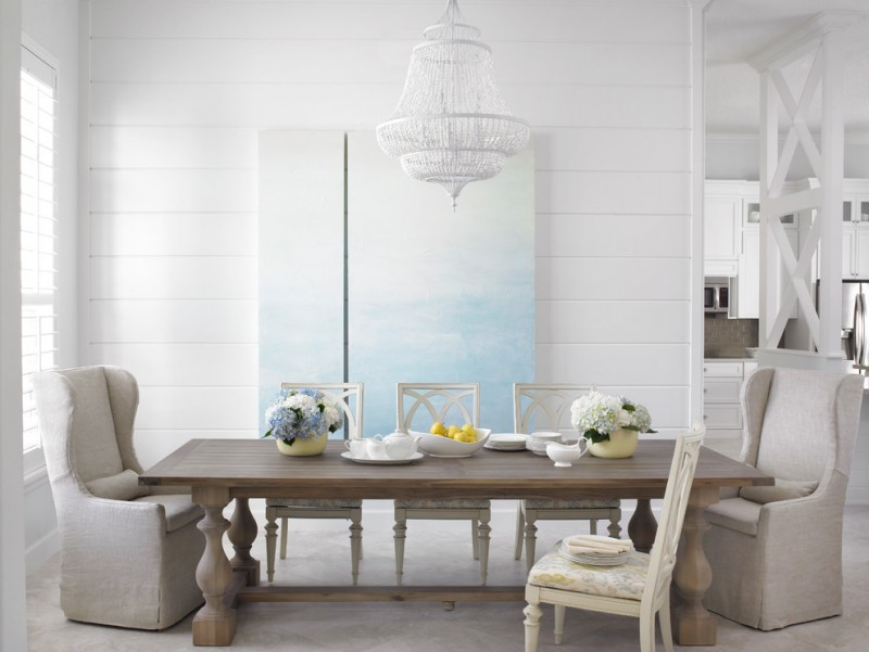 french dining set consisting white painted dining chairs hardwood dining table grey armchairs white siding walls crystal chandelier