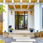 Front Doors With Glass Balcony Black Cedar Soffits Entry Pathway Modern Farmhouse Porch Swing Wall Sconces White Siding