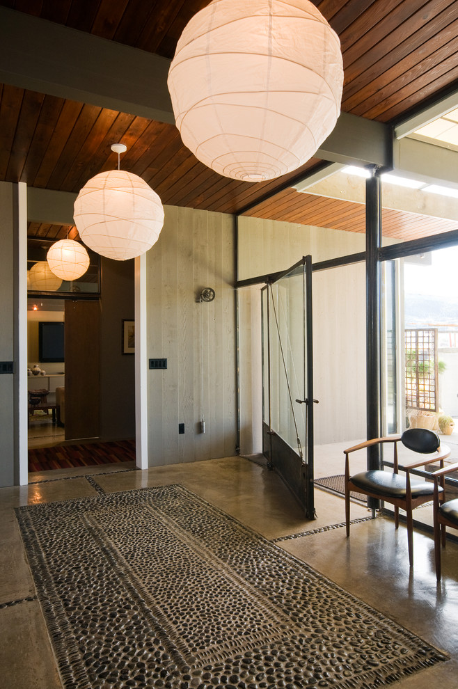 front doors with glass wide glass door and windows minimalist armchairs with black leather cushions nice light fixtures
