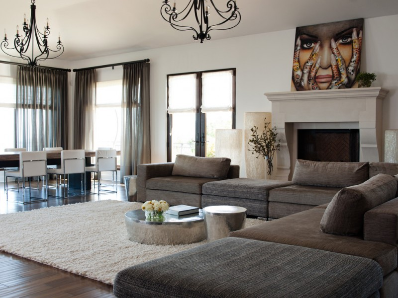 large contemporary open concept family room with white walls, dark hardwood floors, a standard fireplace, a stone fireplace surround and brown floors