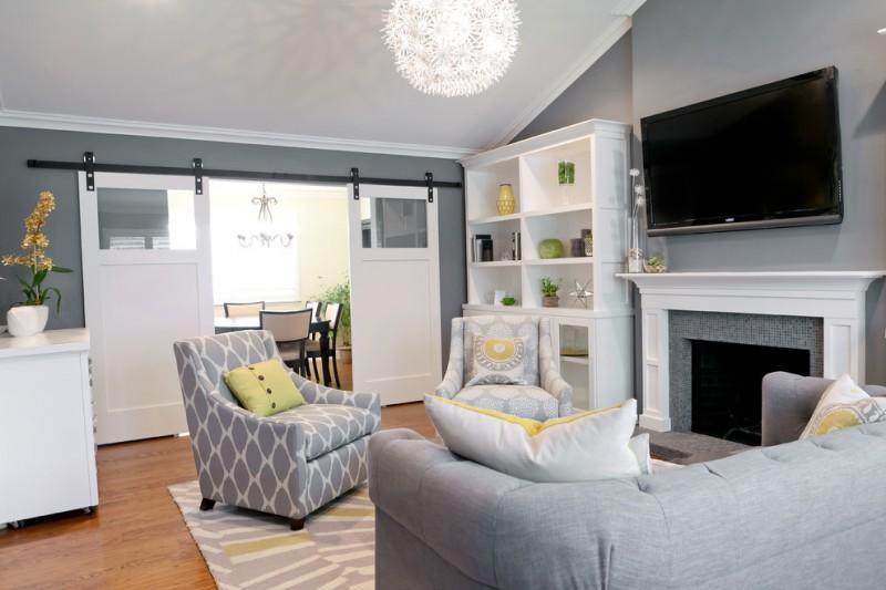 living room color schemes beautiful chandelier fireplace gray patterned rug white big shelves grey furniture barn doors