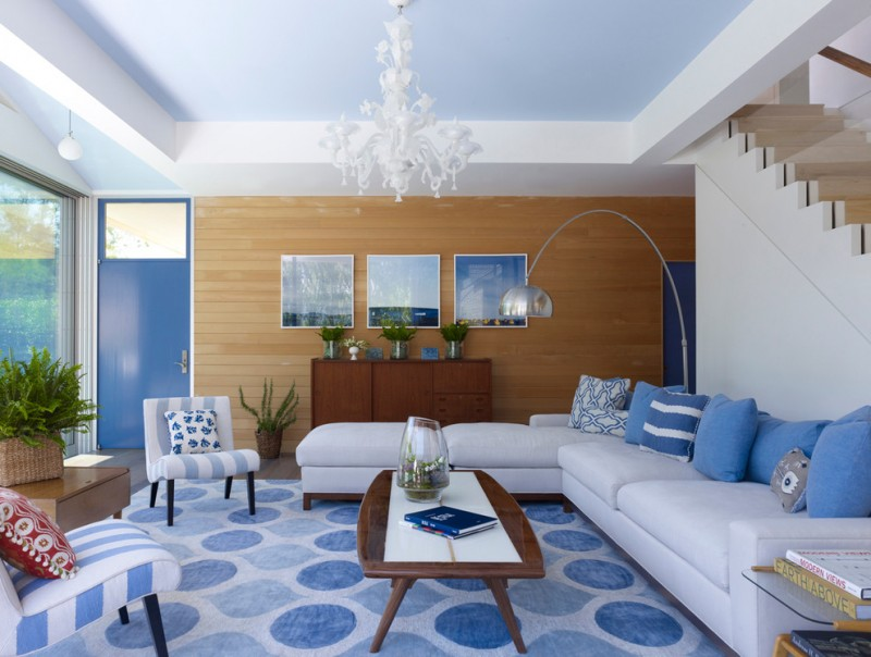 living room color schemes blue color schemes unique chandelier glass railing blue dots rug wood wall wooden coffee table stripes blue chairs large window