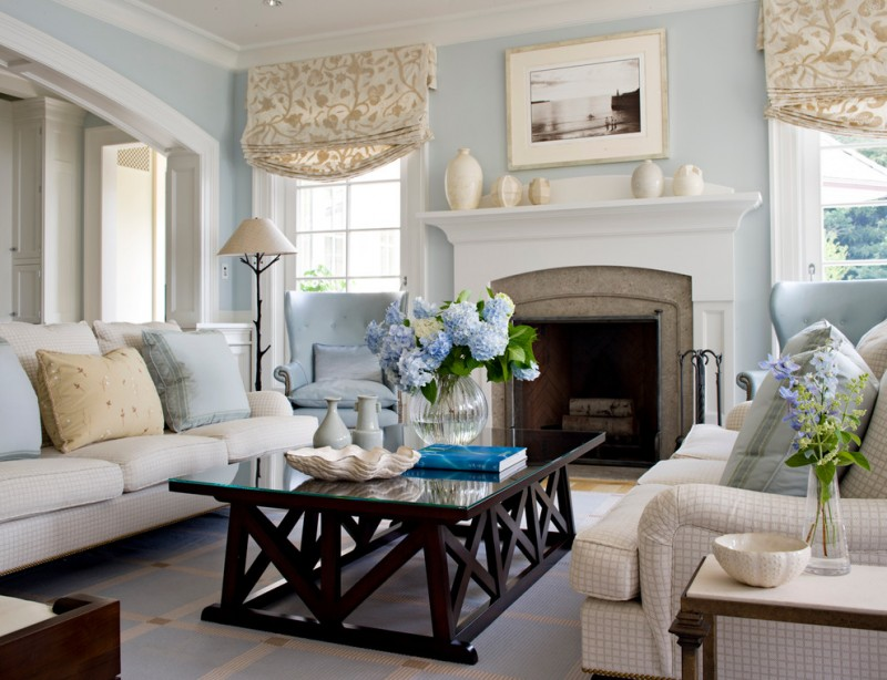 living room color schemes masonry fireplace windows with patterned valances mantel frame black wood table blue rug cream sofa