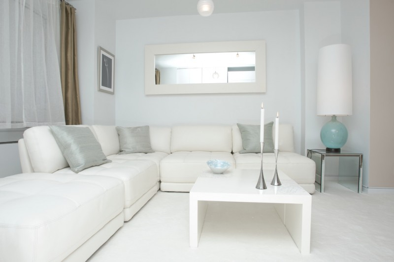 living room color schemes pure white color blue glass table lamp candle holders brown silk curtain wide mirror white coffee table white couch