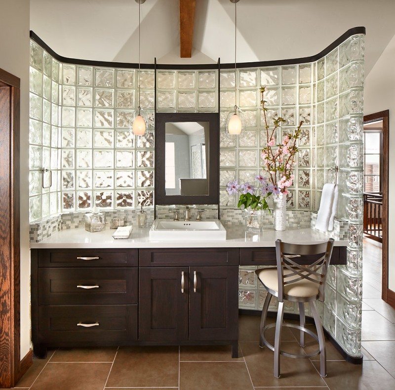 mid sized classic master bathroom with a drop in sink, shaker cabinets, dark wood cabinets, white walls, glass tile, porcelain floors and quartzite countertops