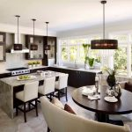 Mid Sized Contemporary L Shaped Eat In Kitchen With Flat Panel Cabinets, Dark Wood Cabinets, A Double Bowl Sink, Quartz Countertops, White Backsplash, Stone Slab Backsplash, Stainless Steel Applianc