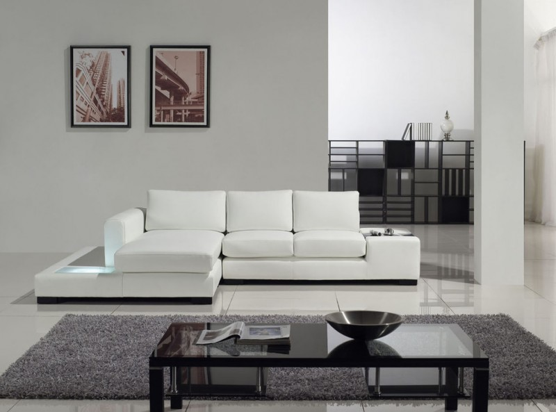 modern living room idea white sectional with additional facing chaise and extended side table white ceramic tiles floors light grey walls grey area rug dark glass top center table